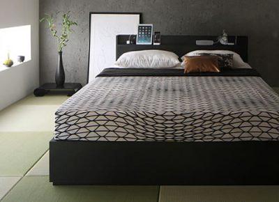 和モダンな寝室とベッド